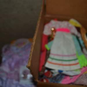 Lot # 254 BOX OF DOLL CLOTHES