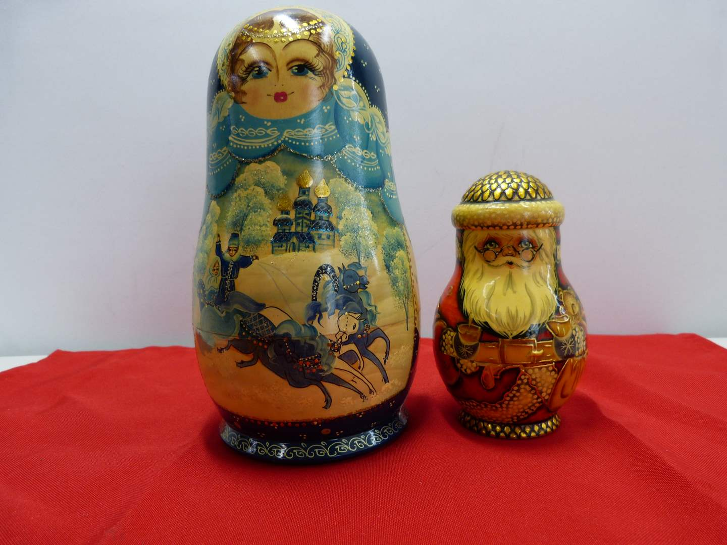 Lot # 61  2 Russian hand painted (and 1 signed) nesting dolls (there are no extras in the Santa) (main image)