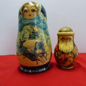 Lot # 61  2 Russian hand painted (and 1 signed) nesting dolls (there are no extras in the Santa)