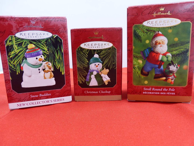 Lot # 105  3 Hallmark Keepsake Christmas ornaments (one artist signed) (main image)