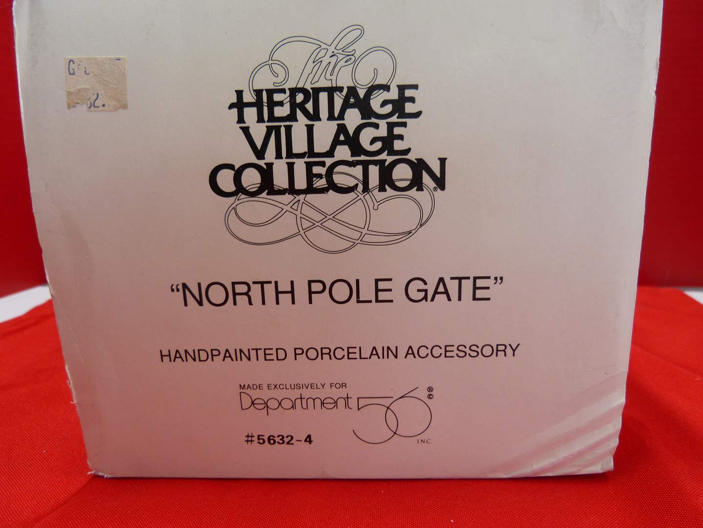 "Lot # 122  Dept 56 Heritage Village ""North Pole Gate"" accessory (main image)"