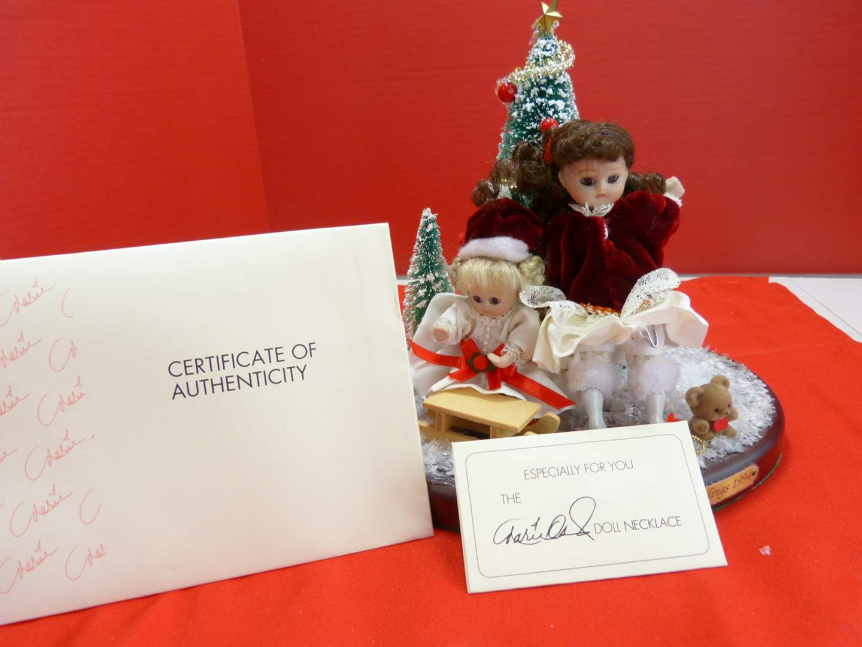 """Lot # 136  Unique Marie Omond """"Petite Amour Series) porcelain dolls (Christmas theme)"""