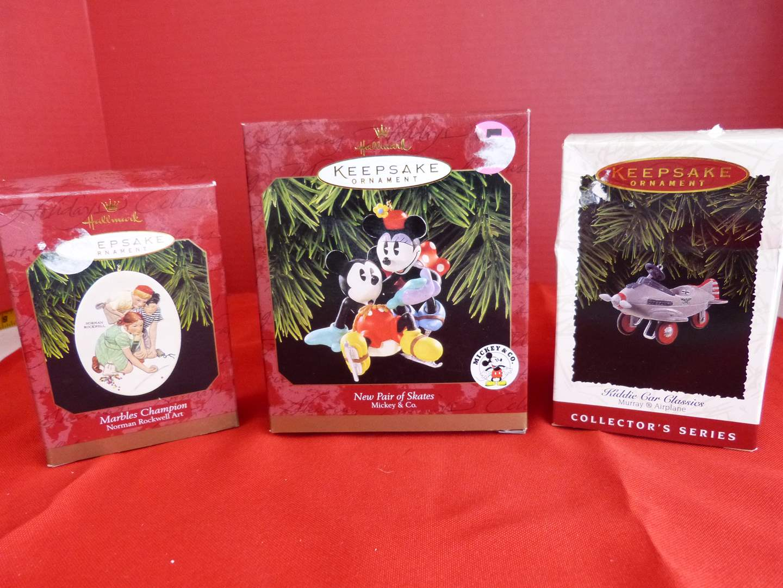 Lot # 157  3 Hallmark Keepsake ornaments to include great Norman Rockwell (main image)