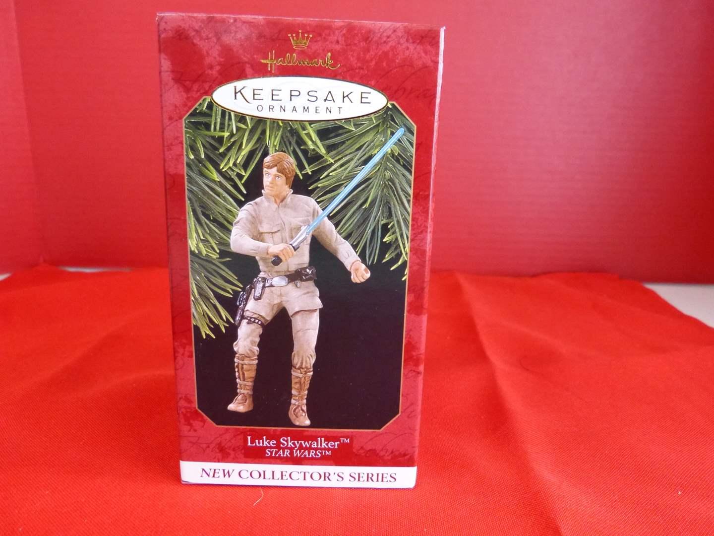 "Lot # 164  Hallmark Keepsake ""Luke Skywalker"" Star Wars ornament  (main image)"