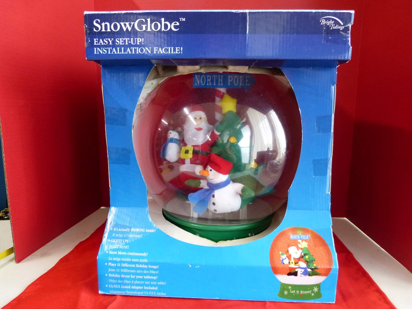 Lot # 188  LARGE snow globe plays 11 different Holiday Songs