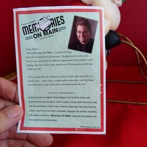 Lot # 192  Memories on Main Santa on sled