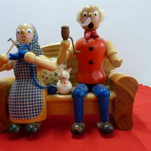 Lot # 208  Great Grandma & Grandpa smoker (appears to be missing 1/2 arm & 1/2 mustache)