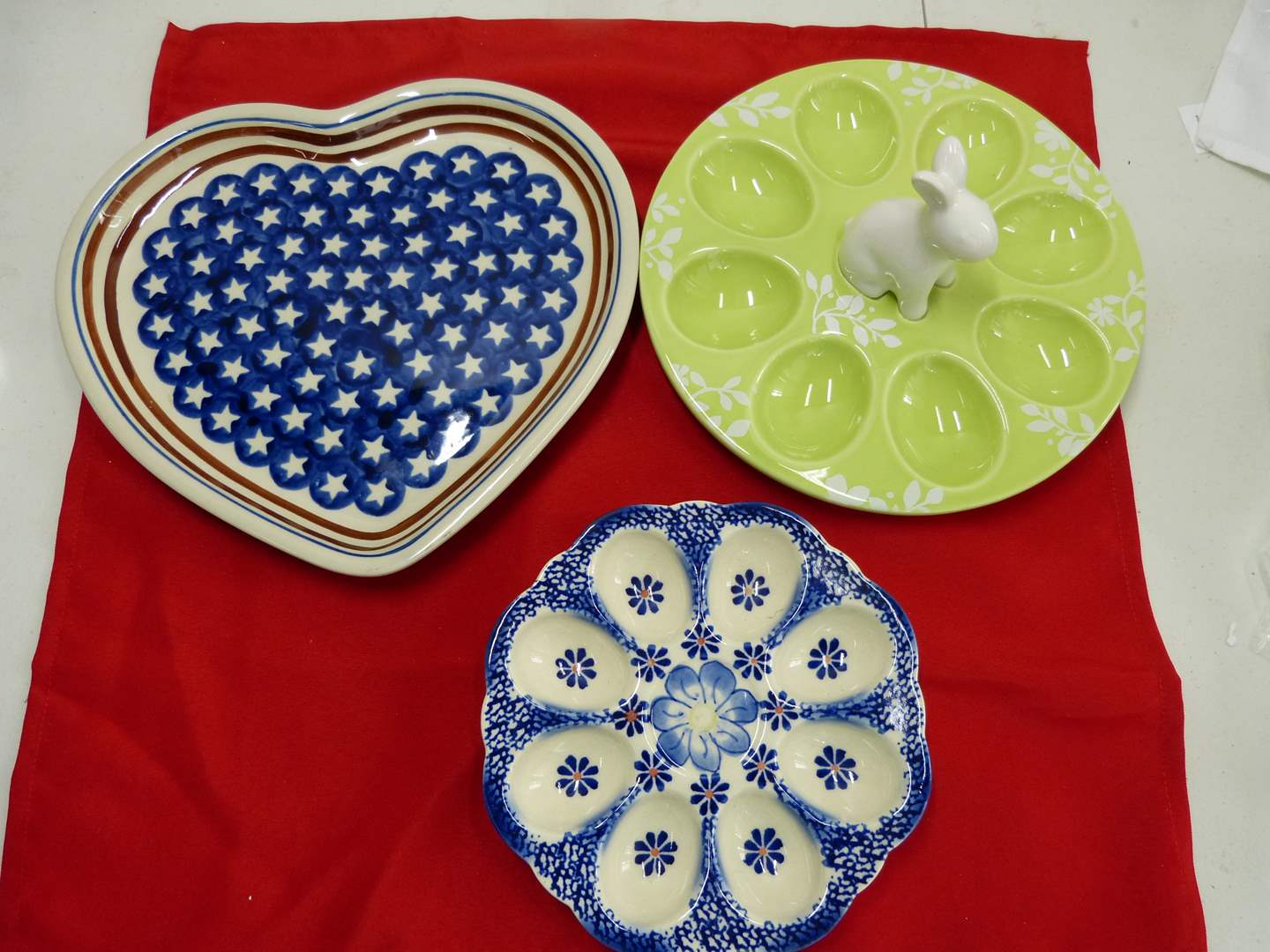 Lot # 231  3 great serving pieces to include 2 deviled egg platters & heart shape pan made in Poland