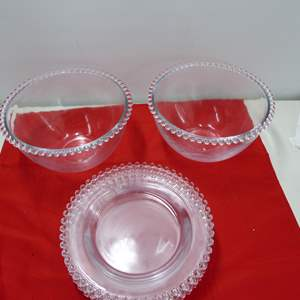Lot # 233  Nice lot of clear crystal Candlewick 4 Plates & 2 large mixing bowls