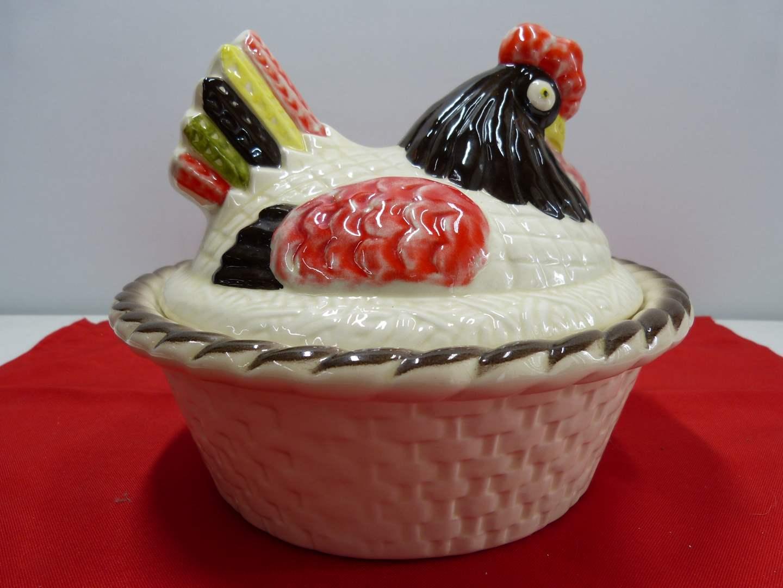 Lot # 235  Large porcelain basket weave covered hen casserole (main image)