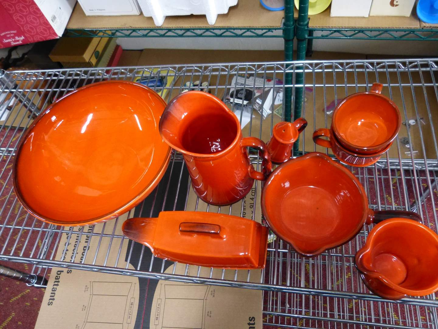 Lot # 238  Large collection of orange with black trim dinnerware/serving pieces unsigned