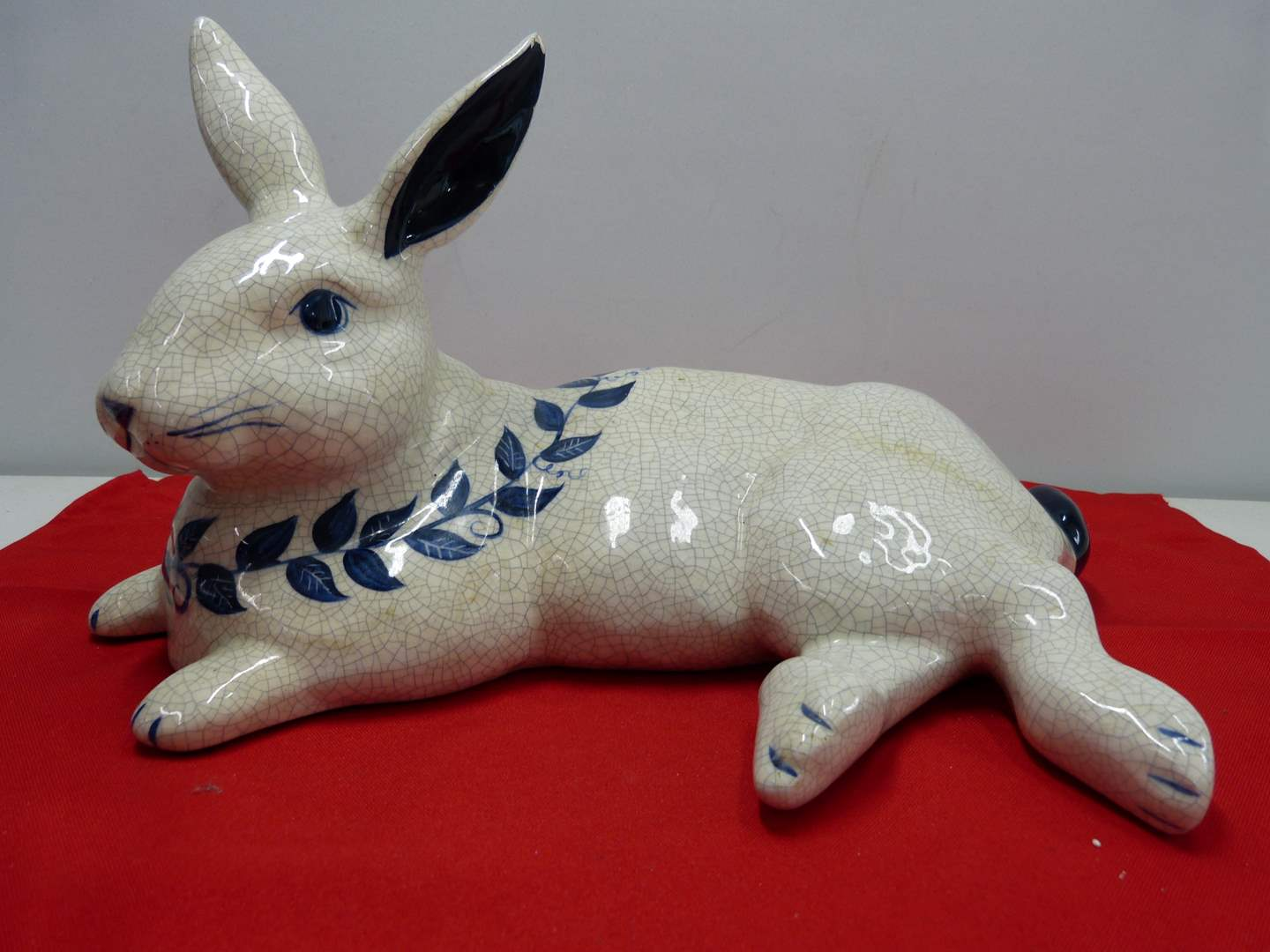 Lot # 241  Large hand painted resting rabbit w/great hand painted cobalt blue accents (has slight chip on top of ear) (main image)