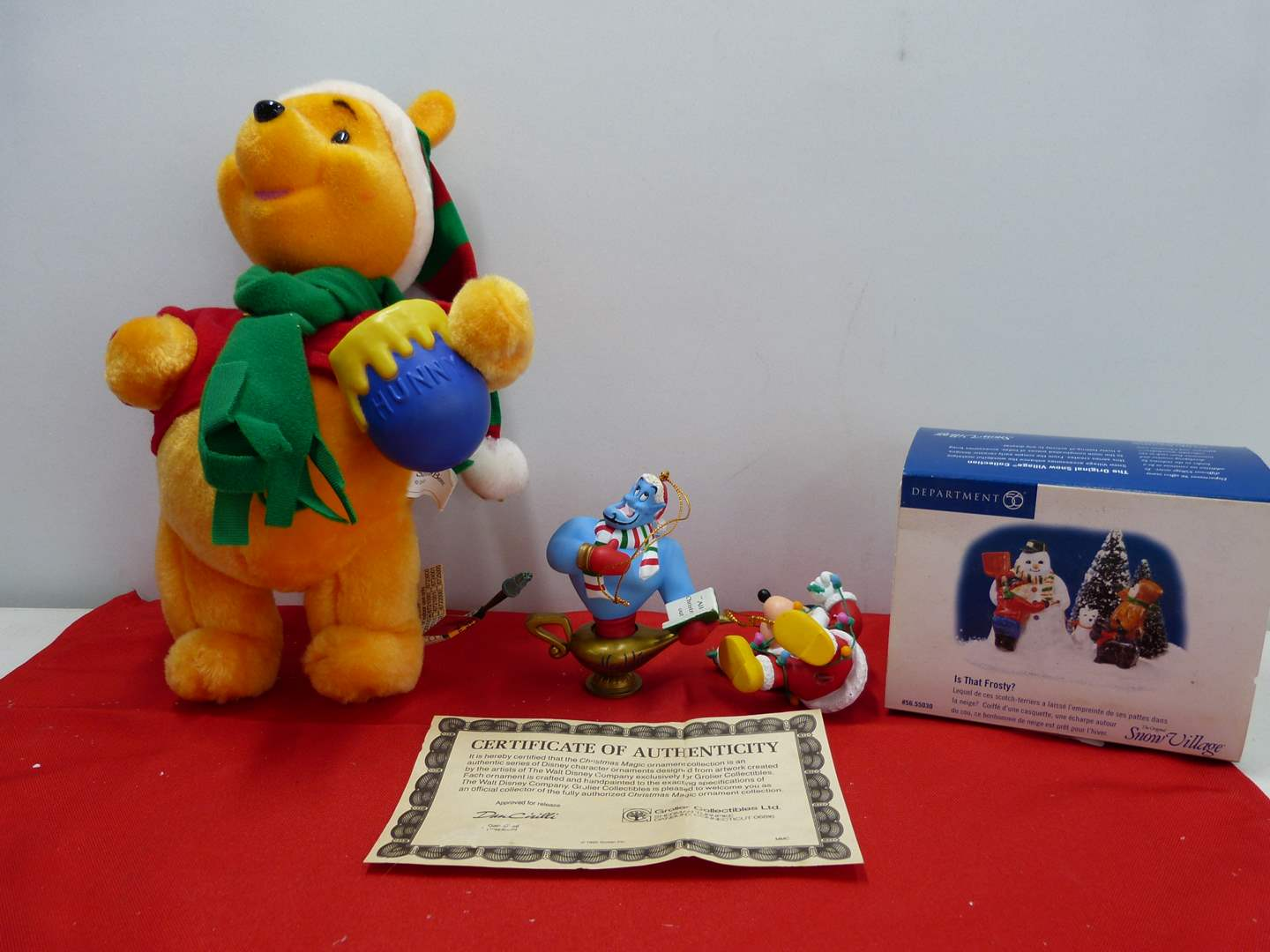 Lot # 261  Nice lot of holiday collectible to include Disney ornaments and Winnie the Pooh (main image)