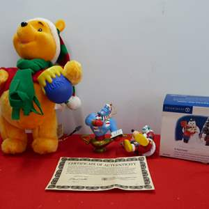 Lot # 261  Nice lot of holiday collectible to include Disney ornaments and Winnie the Pooh