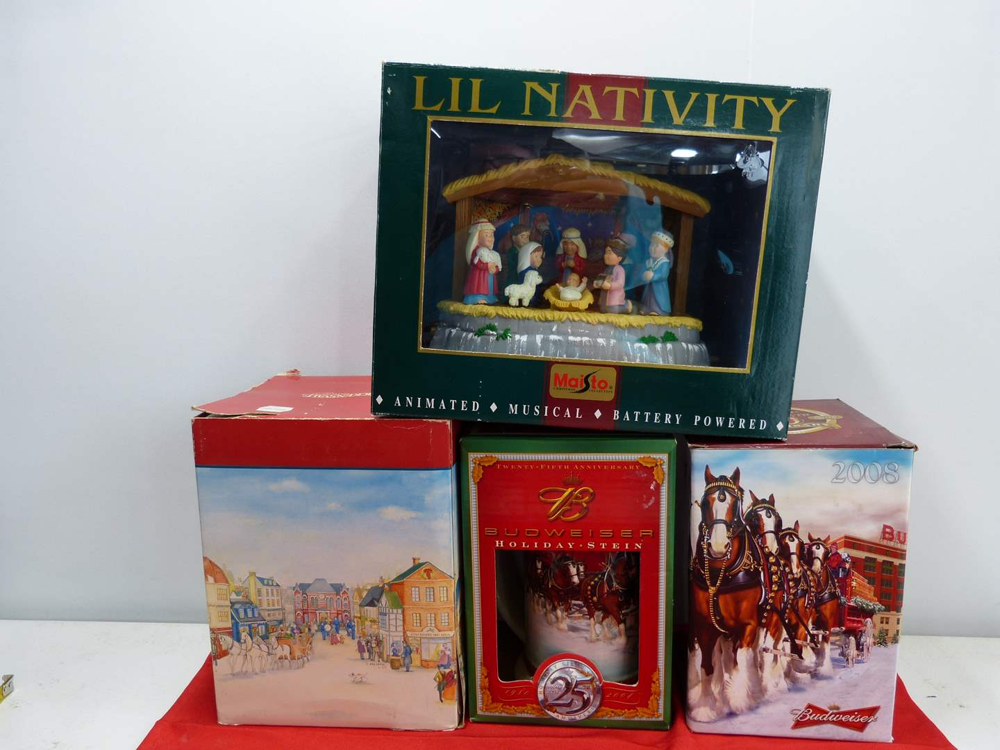 Lot # 267  4 Holiday collectibles to include 2 Budweiser steins