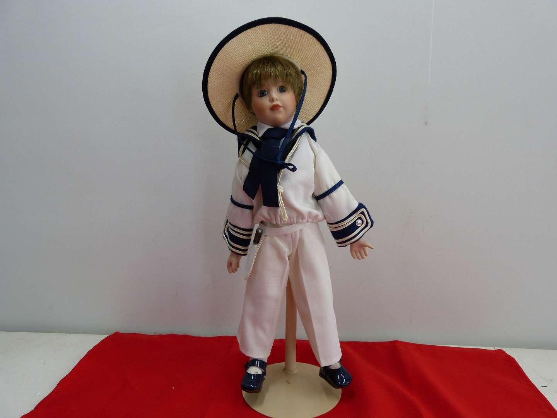 Lot # 285  Young boy in sailor suit porcelain doll