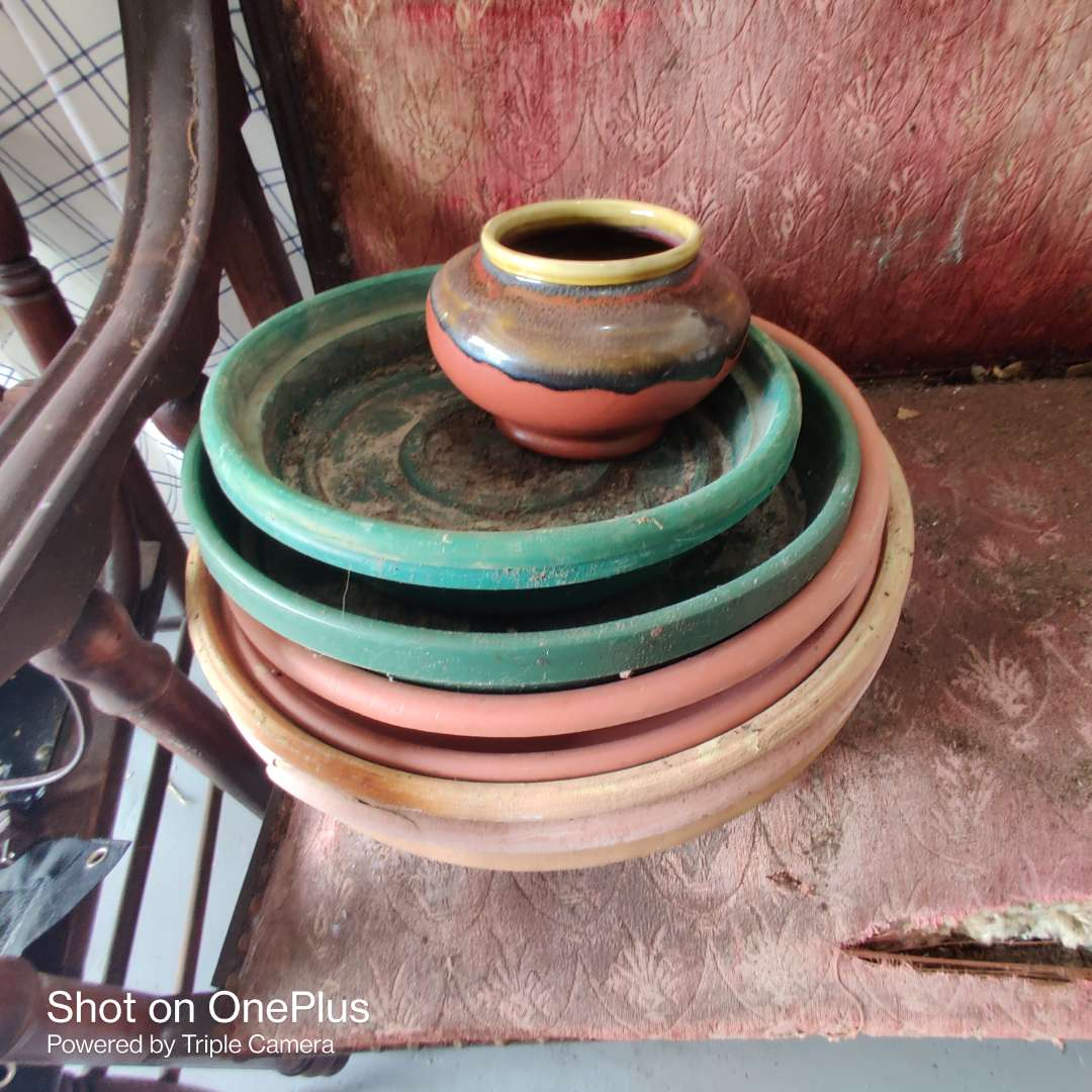 27 pottery planter and plastic planter bases