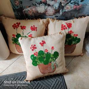 41 lot of three hand-painted pillows with beads