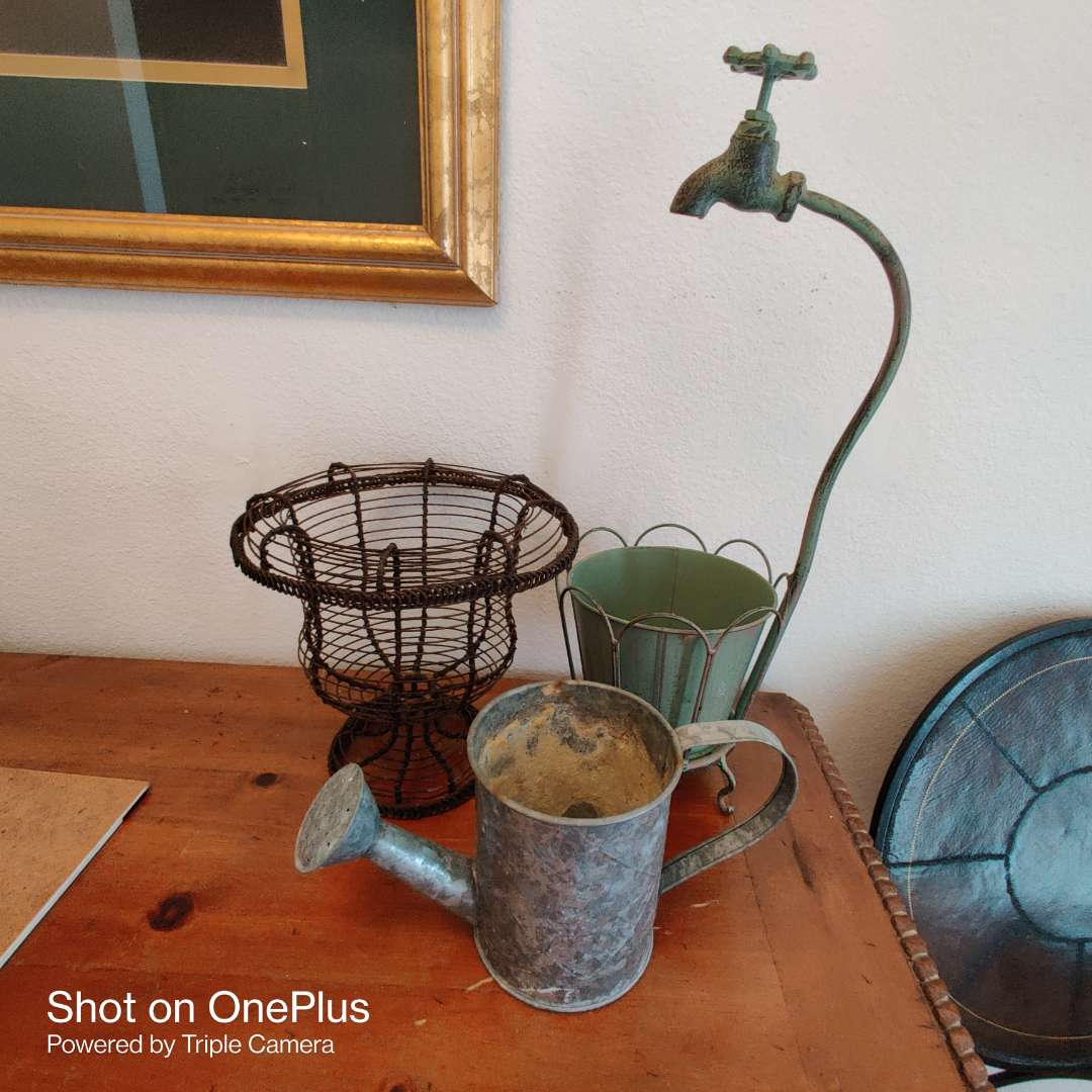 56 Lot of three pieces of metal planter with faucet wire style planter metal watering can
