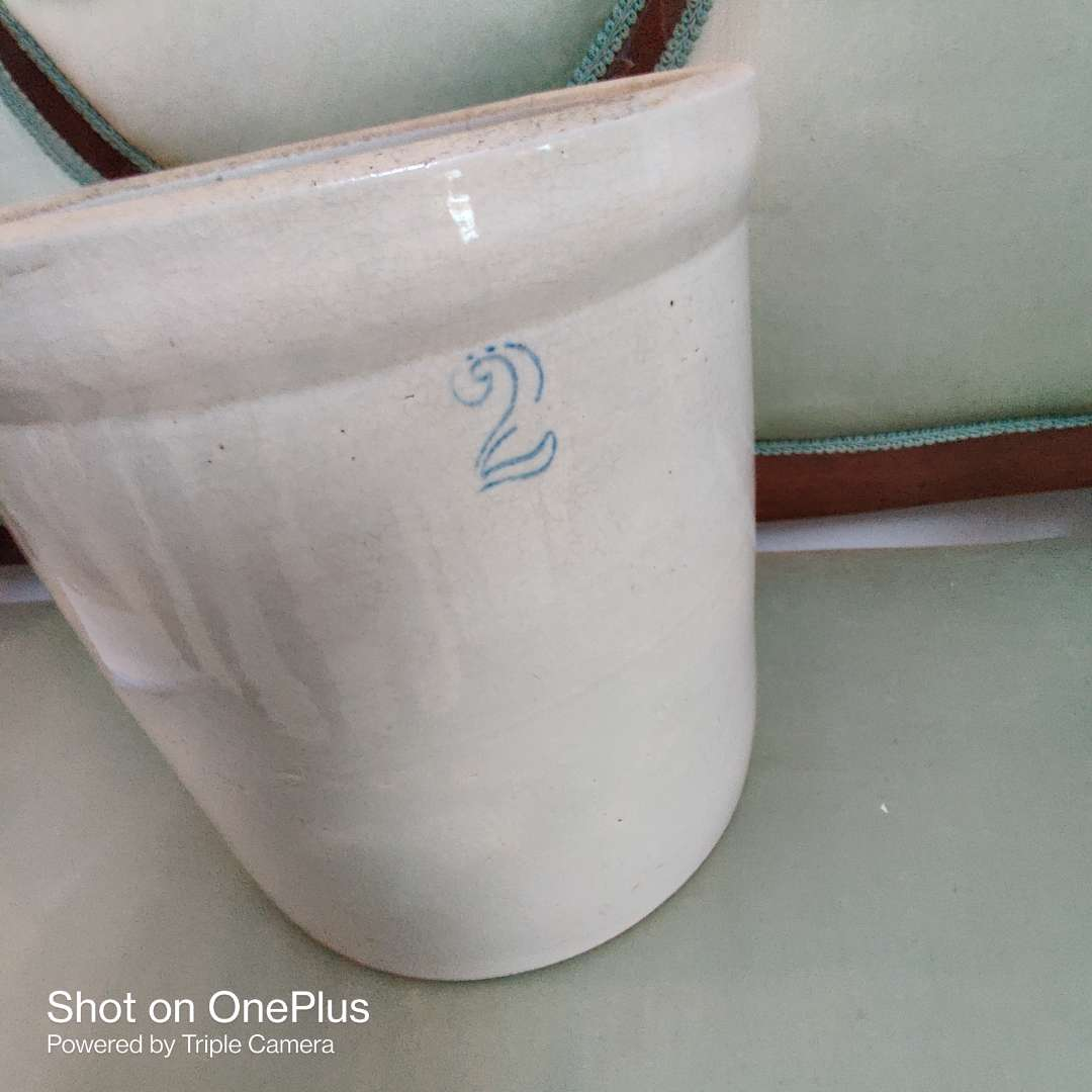 66 2 gallon pottery crock does have a crack