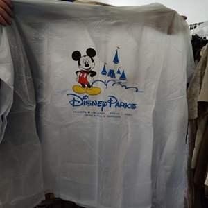 115.  3 Mickey adult ponchos in Disney bag