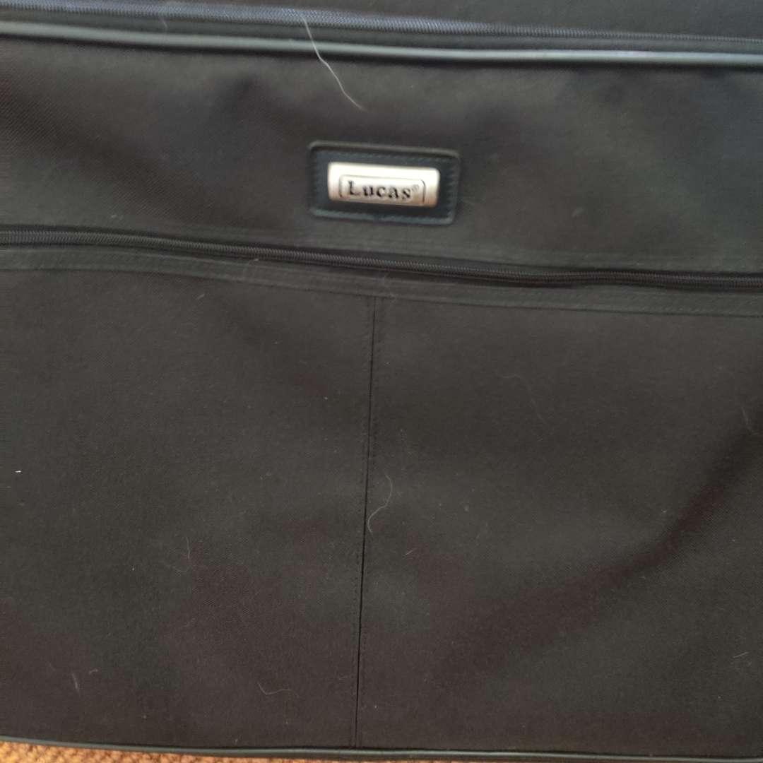 116. Black Lucas garment bag hanging
