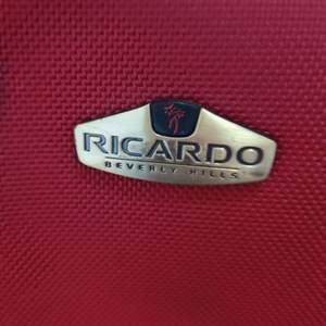 117. Very nice red Ricardo suitcase with lots of compartments