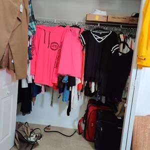 125. Closet full of beautiful clothes