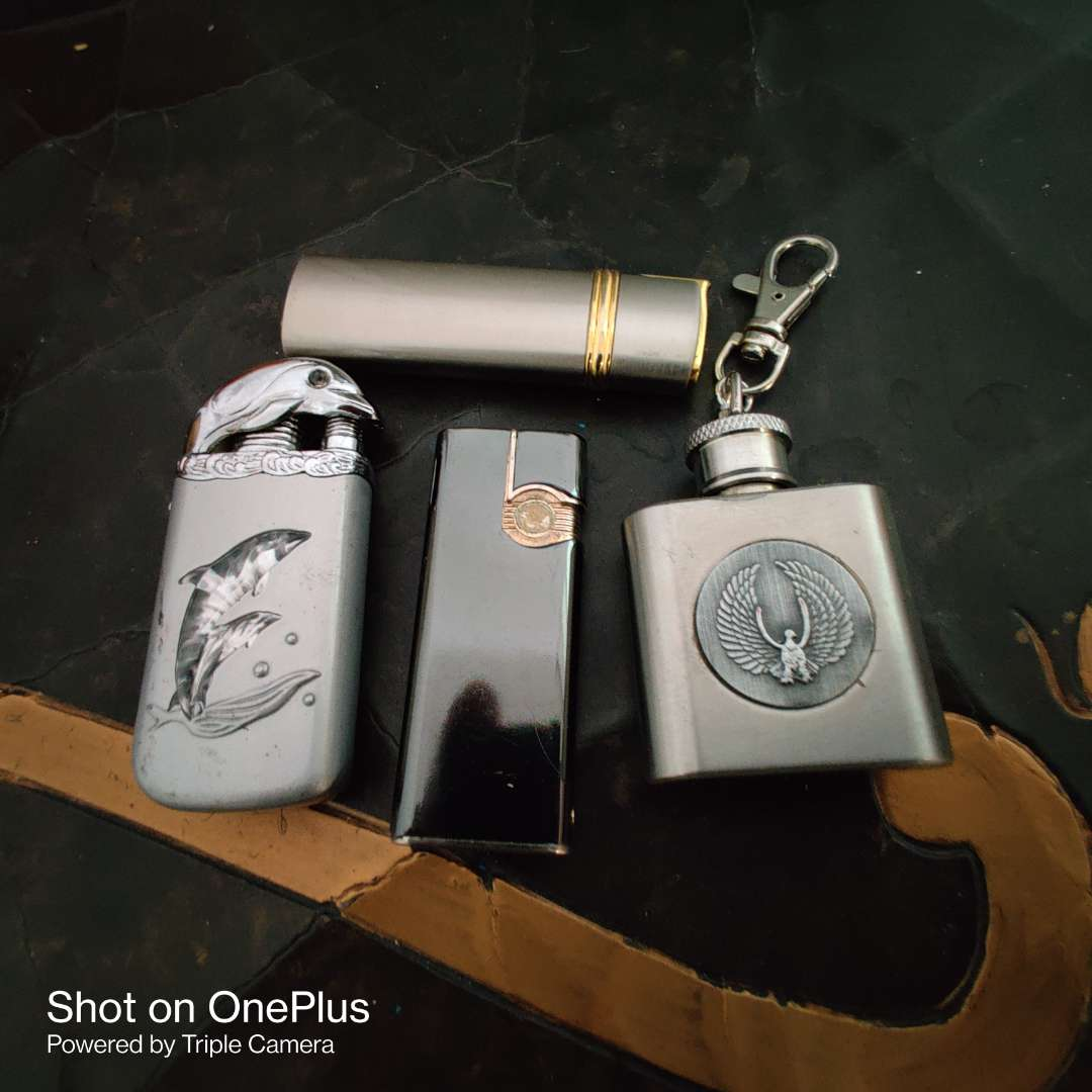 159 lot of four lighters and a miniature flask