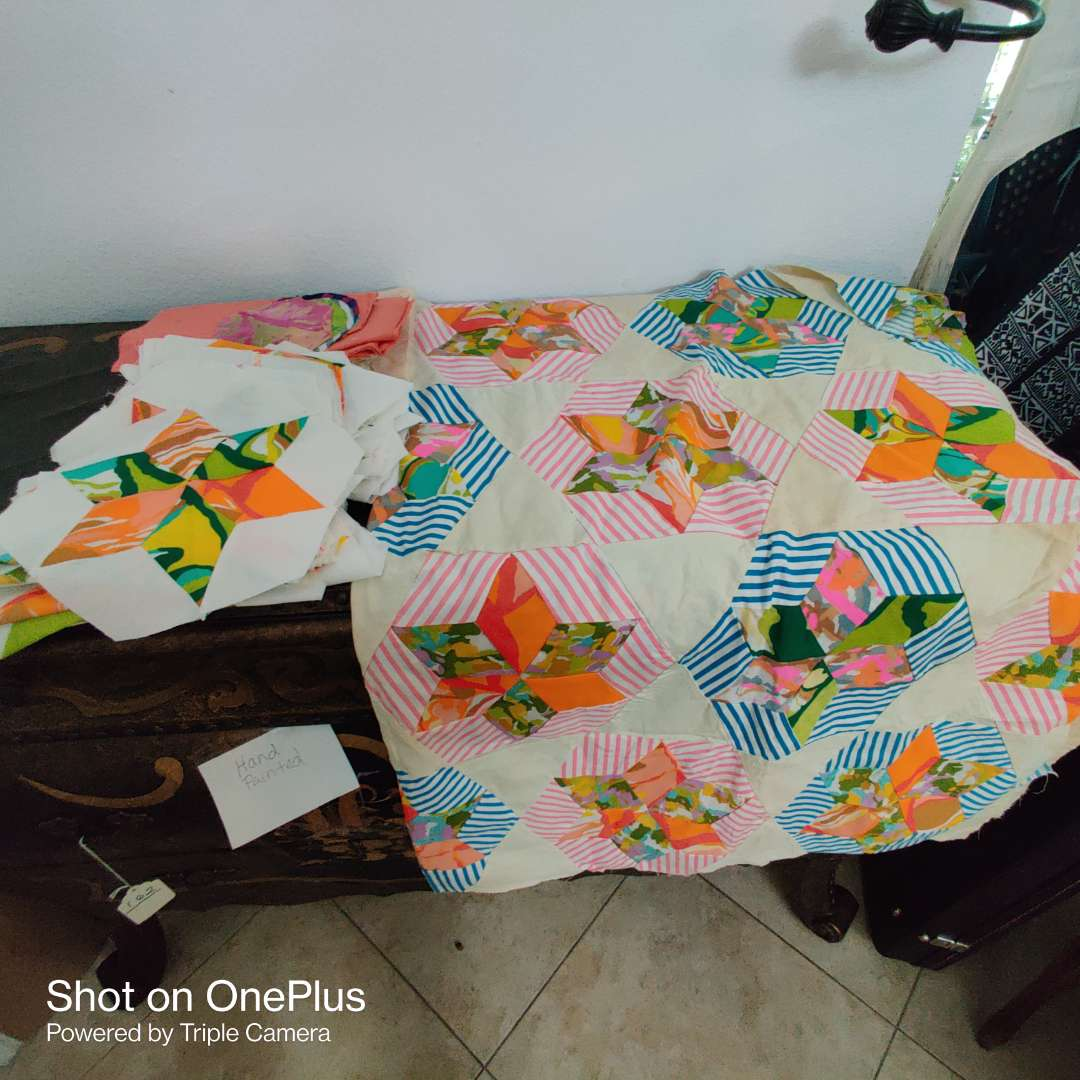 163 partially made quilt topper with extra pieces