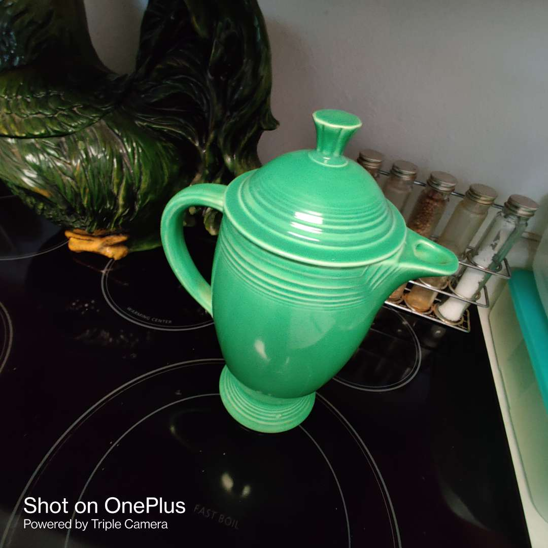 210 fiesta green coffee pot with lid does have a chip