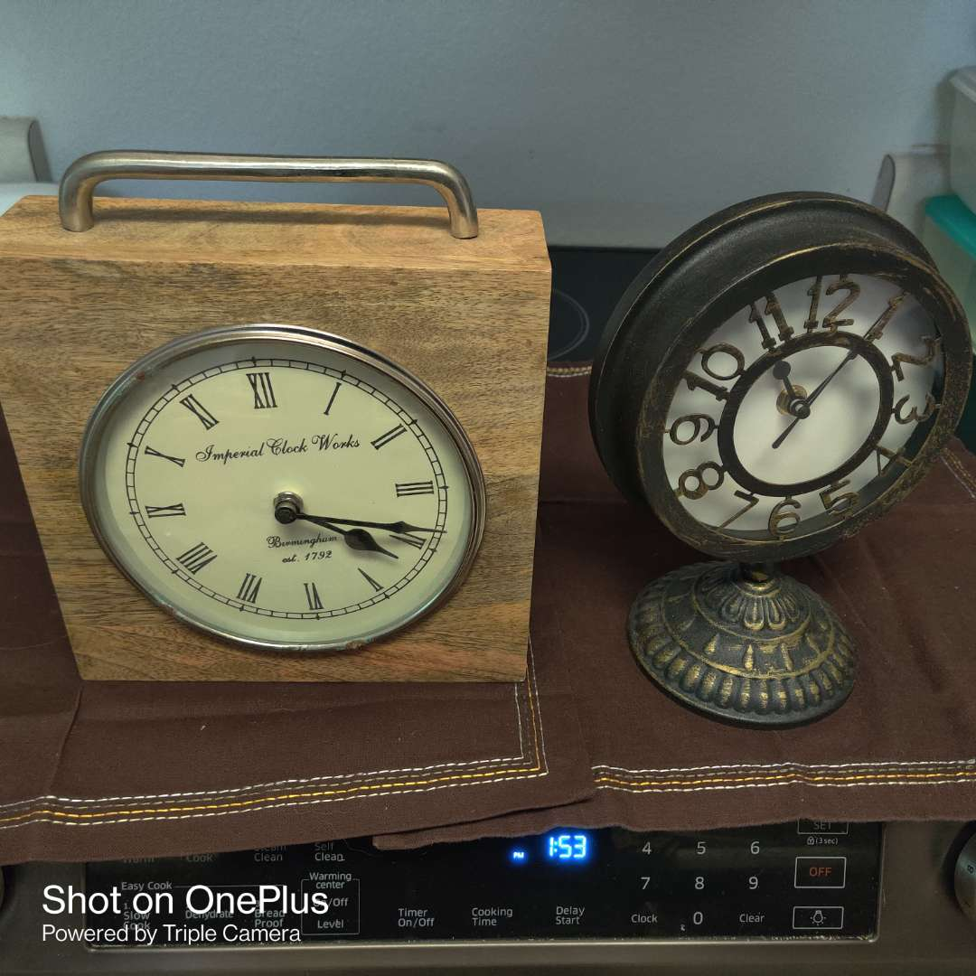 223 two very nice clocks both quarts one imperial clock and metal clock