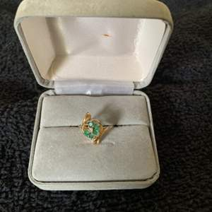 Lot # 44  Pretty 14k With Emeralds Ring. Size 6.5. 2.00 Grams. See Below