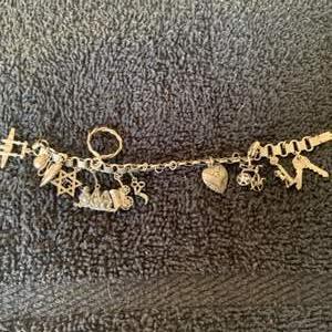 Lot # 90  Gorgeous Sterling Silver Charm Bracelet. 29.74 Grams
