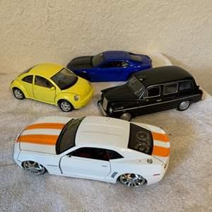 Lot # 220  Lot 4 Assorted Die Cast Cars. See Pics For Description