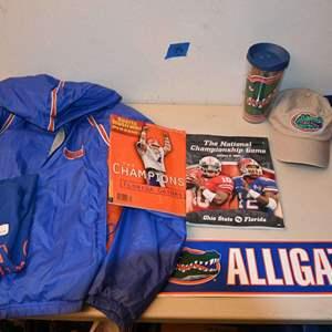 Lot # 115 FLORIDA GATORS jacket hoodie, cup, metal sign, misc...