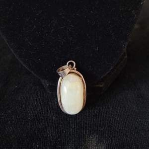 Lot # 256 Beautiful Stone Pendant w/ Sterling Wrap