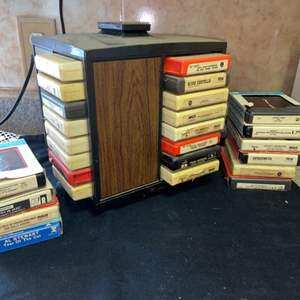 Lot # 608 Blast from the Past!  Assortment of 8 Track Tapes and Holder