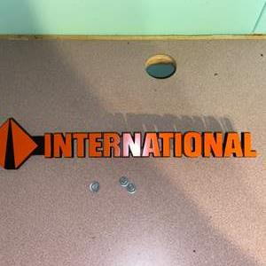 Lot # 1093 International Trucking Metal Sign