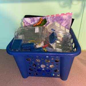 Lot # 1096 Basket Full of Plastic Containers