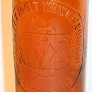 Lot # 43 1886 DUFFY MALT WHISKEY brown bottle