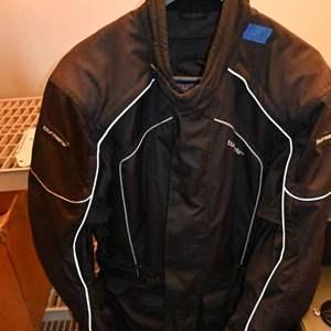 Lot # 51 TOURMASTER Saber Series 2 motorcycle LG 42 jacket with armor