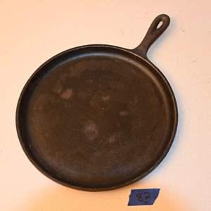 "Lot # 82 CRACKER BARREL 10-1/2"" round cast iron griddle"