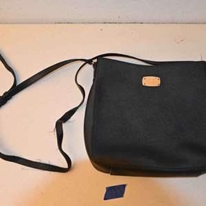 Lot # 133 MICHAEL KORS black purse with frayed strap