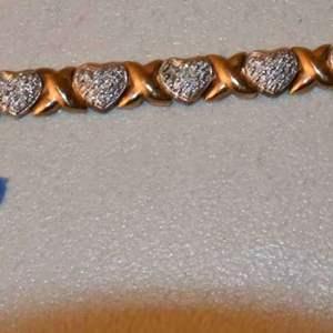 """Lot # 141 Sterling silver Hearts & X's tennis bracelet 7-1/2"""" 18.0g"""