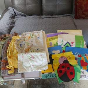 Lot #323 Aprons, Table Linens, Flags and Towels