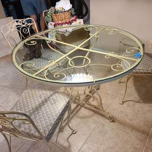 Lot # 259 Wrought Iron Glass Top Table w/ Four Matching Chairs (Cream in Coloring)