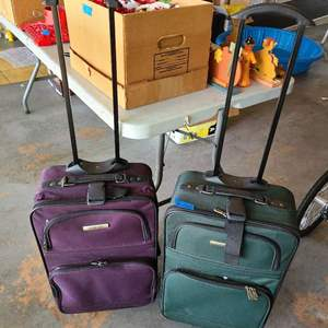 Lot # 261 Lot of 2 Rolling Luggage  (small)