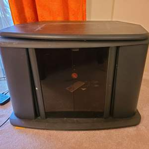 Lot # 100 Small Entertainment Center With Swivel Top
