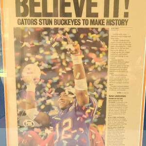 Lot # 247 Gators Championship Newspaper Article (Framed)